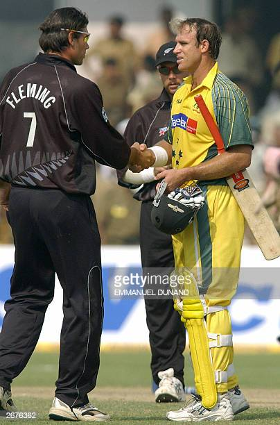 Australian batsman Mattew Hayden is congratulated by New Zealand captain Stephen Fleming 29 October 2003 at the end of the One Day International...