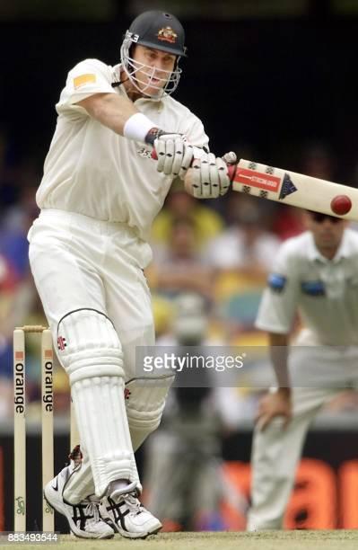 Australian batsman Matthew Hayden pulls a ball away from New Zealand bowler Shane Conner for four run on the first morning of the first Test Match...