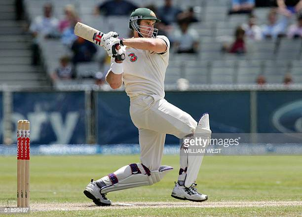 Australian batsman Matthew Hayden pulls a ball away to the boundary as Australia defeats Pakistan on the fourth day of the second Test match being...