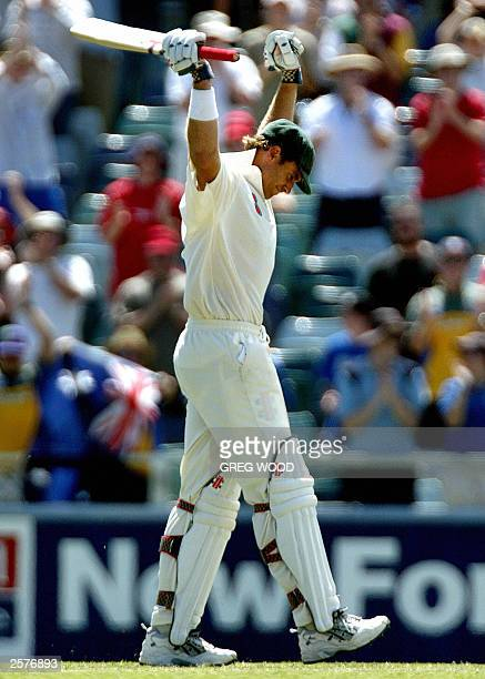 Australian batsman Matthew Hayden raises his arms after scoring a triple century on his way to scoring the highest test score of all time during the...