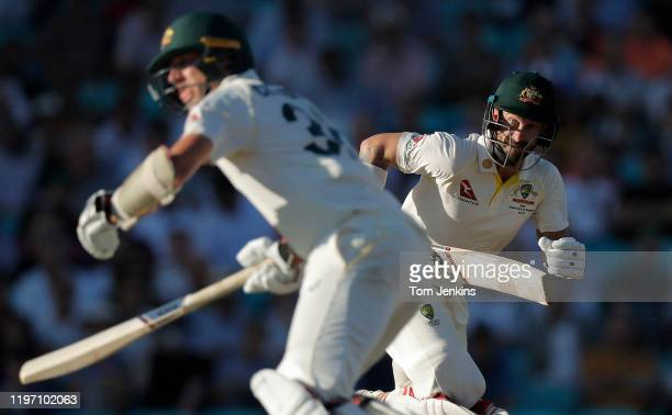 Australian batsman Matthew Wade runs a quick single with partner Pat Cummins during day four of the England v Australia 5th Ashes test match at The...