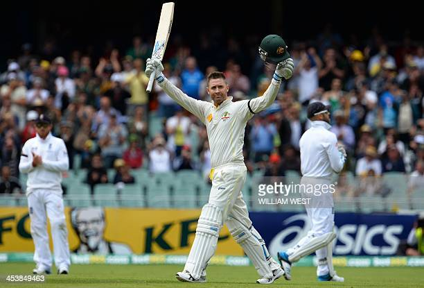 Australian batsman Michael Clarke celebrates after scoring his century against England on the second day of the second Ashes cricket Test match in...