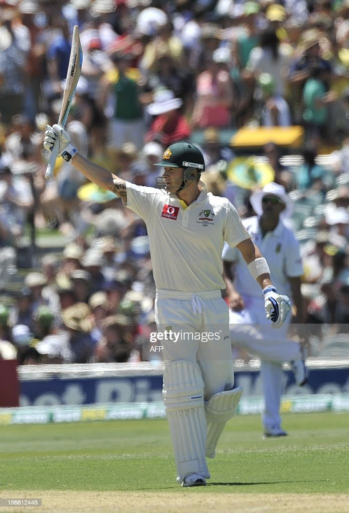 Australian Batsman Michael Clarke celebrates his 50 runs batting against South Africa on the first day of the second cricket Test match at the Adelaide Oval on November 22, 2012. AFP PHOTO/David Mariuz IMAGE