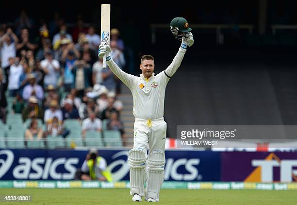 Australian batsman Michael Clarke celebrates scoring his century against England on the second day of the second Ashes cricket Test match in Adelaide...