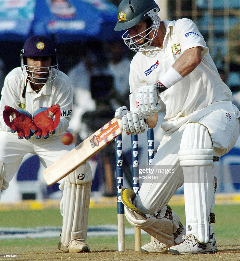 Australian batsman, Michael Kasprowicz (R) plays a stroke as wicketkeeper Dinesh Kartik (L) looks on at the Wankhede Stadium, Bombay, 04 November 2004, on day two of the fourth Test between Australia and India. Australia were all out for 203 in response to India's first innings score of all out for 104 runs. AFP PHOTO/Rob ELLIOTT