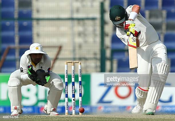 Australian batsman Peter Siddle plays a shot during the third day of the second test cricket match between Pakistan and Australia at the Zayed...