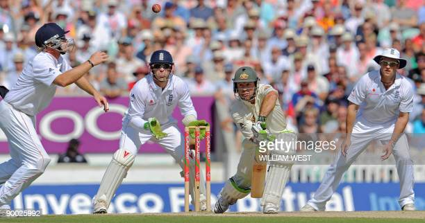 Australian batsman Ricky Ponting defends as England players Ian Bell , Matt Prior and Andrew Strauss look on on the fourth day of the fifth and final...