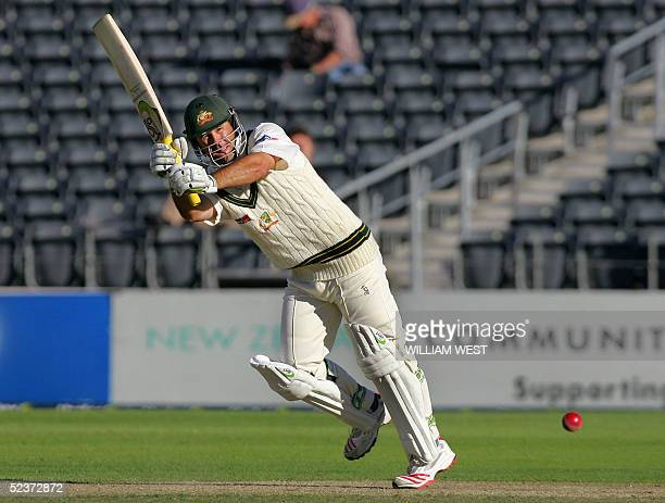 Australian batsman Ricky Ponting flicks a ball off his legs from the New Zealand bowling, on the second day of the first Test being played in...