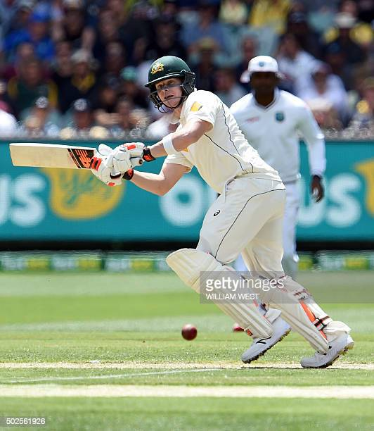 Australian batsman Steve Smith flicks a ball to leg from the West Indies bowling on the second day of the second cricket Test in Melbourne on...