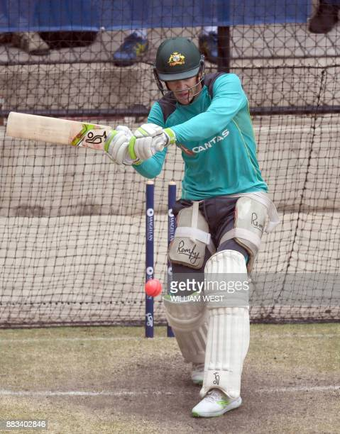 Australian batsman Tim Paine bats in the nets during training on the eve of the second Ashes cricket Test match against England in Adelaide on...