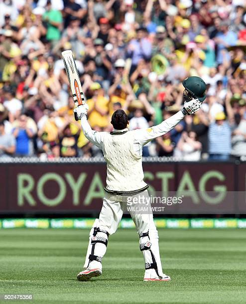 Australian batsman Usman Khawaja celebrates scoring his century against the West Indies on the first day of the second cricket Test in Melbourne on...