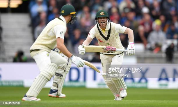 Australian batsmen David Warner and Marnus Labuschagne run between the wickets during day one of the 3rd Specsavers Ashes Test match between England...