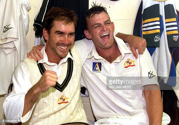 Australian batsmen Justin Langer and Adam Gilchrist celebrate in the dressing rooms after taking Australia to victory over Pakistan on the final day...