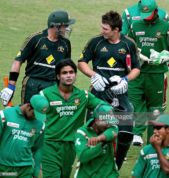 Australian batsmen Michael Hussey and Shaun Marsh leave the field with the Bangladesh side after guiding Australia to victory in the second oneday...