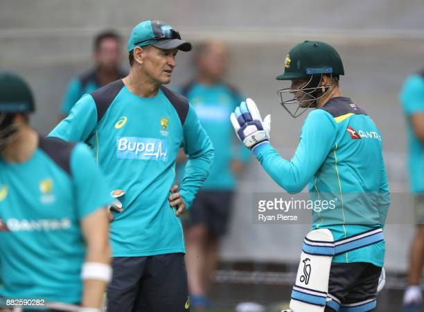 Australian Batting Coach Graeme Hick speaks to Peter Handscomb of Australia during an Australian nets session at Adelaide Oval on November 30 2017 in...