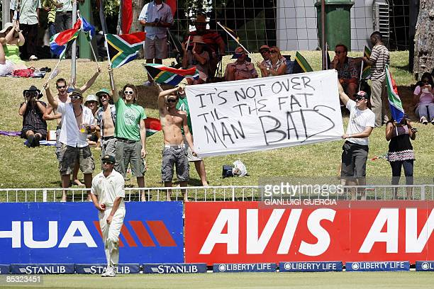 Australian Ben Hilfenhaus fields as South African supporters hold a banner on March 10 2009 during the fifth and last day of the second Test match...