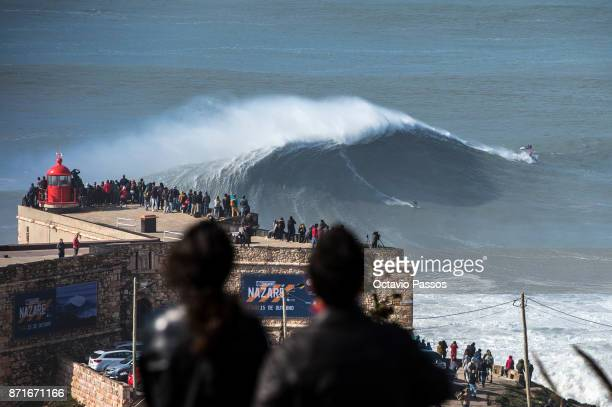 Australian big wave surfer Mick Corbett drops a wave during a surf session at Praia do Norte on November 8 2017 in Nazare Portugal