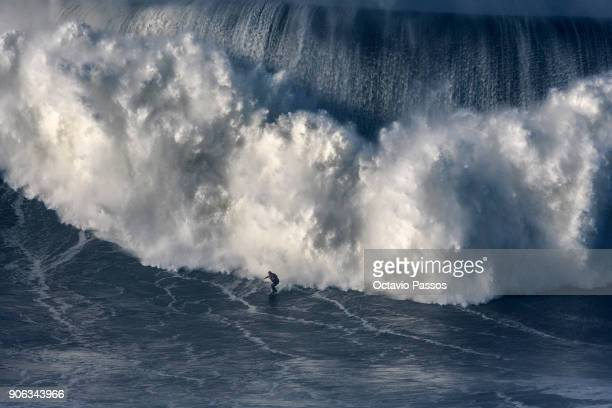 Australian big wave surfer Ross ClarkeJones drops a wave during a surf session at Praia do Norte on January 18 2018 in Nazare Portugal