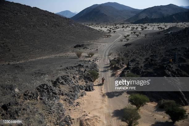 Australian biker Toby Price powers his KTM during Stage 4 of the Dakar Rally 2021 between Wadi Ad-Dawasir and Saudi Arabia's capital Riyadh, on...