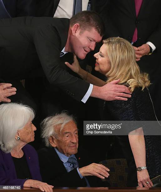 Australian Billionaire businessman James Packer greets Sara Netanyahu while Elie Wiesel sits below moments before Israeli Prime Minister Benjamin...