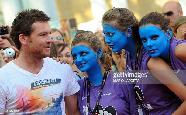 Australian born English actor Sam Worthington star of James Cameron's Avatar blockbuster film jokes with his fans painted blue like Avatar as he...