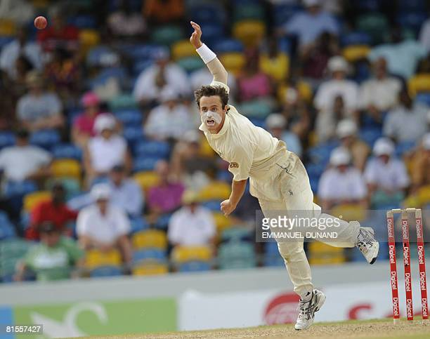 Australian bowler Beau Casson delivers a ball as he makes his test cricket debut, during the second day of the third test match between the West...