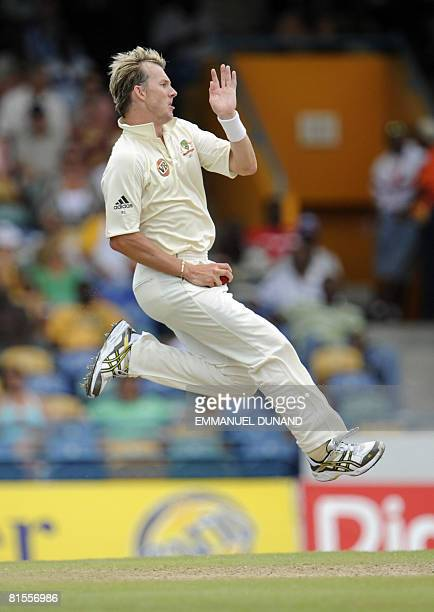 Australian bowler Brett Lee delivers a ball, during the second day of the third test match between the West Indies and Australia June 13, 2008 at the...