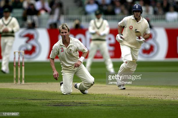 Australian bowler Brett Lee watches the ball as Andrew Strauss makes a run in Day One of the Fourth Ashes Test at the Melbourne Cricket Ground...