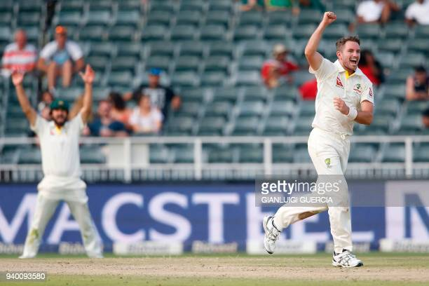 Australian bowler Chadd Sayers celebrates the dismissal of South African batsman AB de Villiers on the first day of the fourth Test cricket match...