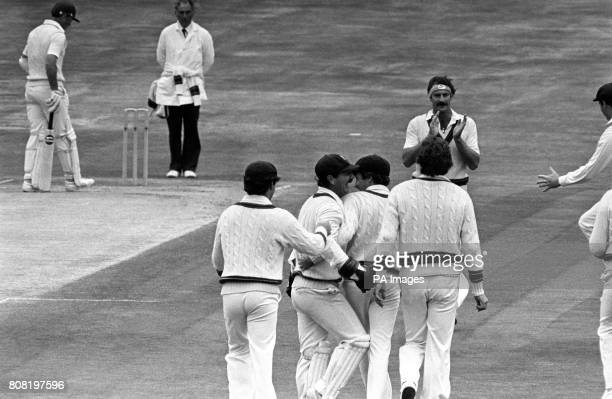 Australian bowler Dennis Lillee applauds fellow team mate Terry Alderman for the catch of England batsman Mike Brearley as other members of the...