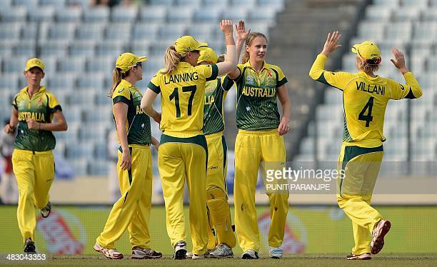 Australian bowler Ellyse Perry celebrates with teammates after taking the wicket of England batswoman Amy Jones during the ICC Women's World Twenty20...