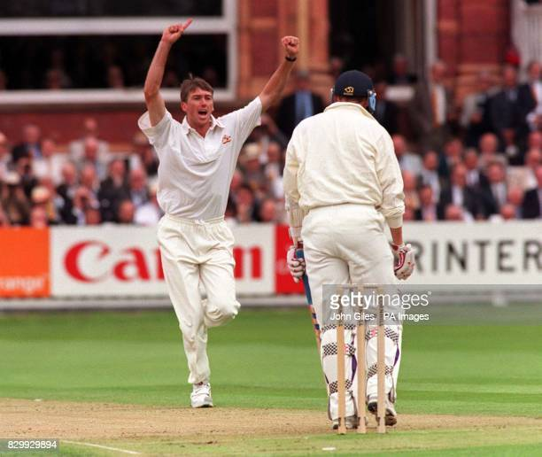 Australian bowler Glen McGrath celebrates as England captain Mike Atherton is caught by Mark Taylor during the second Cornhill Test at Lords today...
