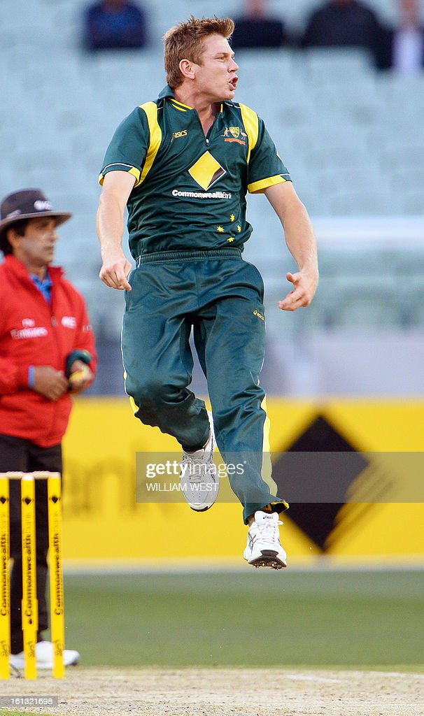 Australian bowler James Faulkner leaps in the air in despair as West Indies batsman Johnson Charles hits over the infield in their one-day cricket international played at the Melbourne Cricket Ground (MCG), on February 10, 2013. AFP PHOTO/William WEST IMAGE