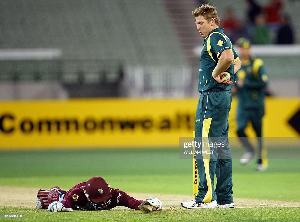 Australian bowler James Faulkner (R) looks down at West Indies batsman Devon Thomas (L) after running him out in their one-day cricket international played at the Melbourne Cricket Ground (MCG), on February 10, 2013. AFP PHOTO/William WEST IMAGE