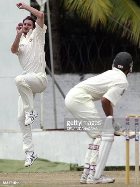 Australian bowler Jason Gillespie delivers a ball against Pakistani batsman Younis Khan during the 4th day's play of the first cricket test match...