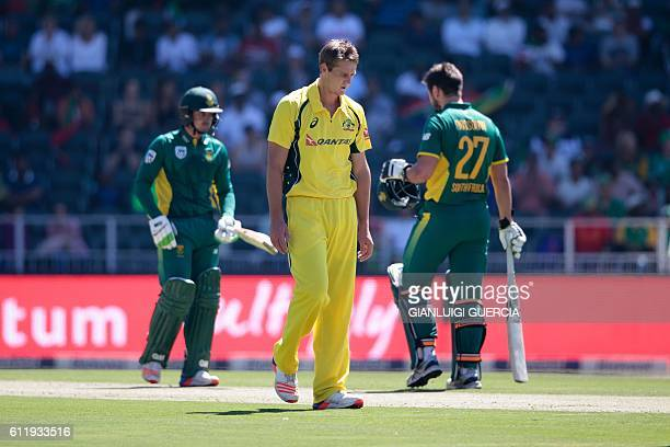 Australian bowler Joe Mennie reacts after bowling on South African batsman Quinton de Kock during the ODI match between South Africa and Australia at...