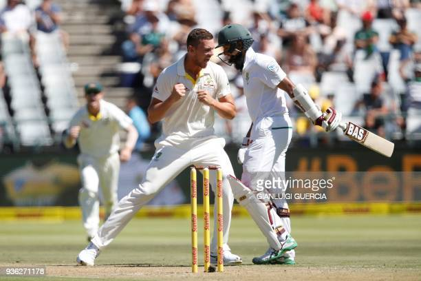 Australian bowler Josh Hazlewood celebrates the dismissal of South African batsman Hashim Amla during the first day of the third Test cricket match...