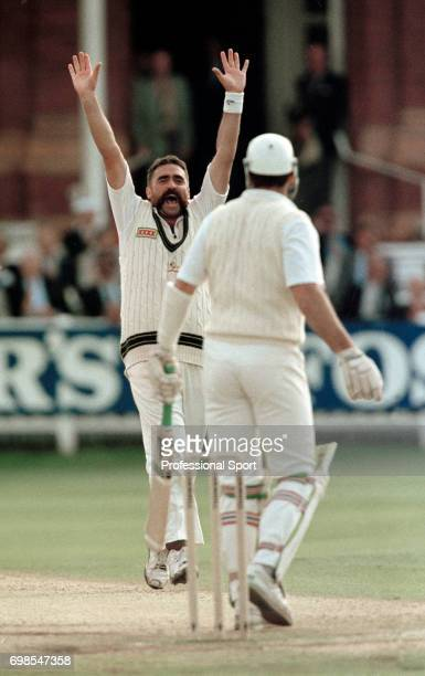 Australian bowler Merv Hughes celebrates the wicket of England batsman Graeme Hick during the 2nd Test match between England and Australia at Lord's...