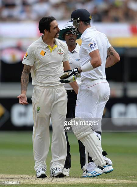 Australian bowler Mitchell Johnson and England's Kevin Pietersen exchange words on the third day of the fourth Ashes cricket Test match against...