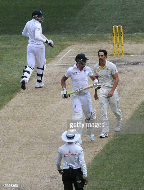 Australian bowler Mitchell Johnson and England's Kevin Pietersen react on the third day of the fourth Ashes cricket Test match against Australia in...