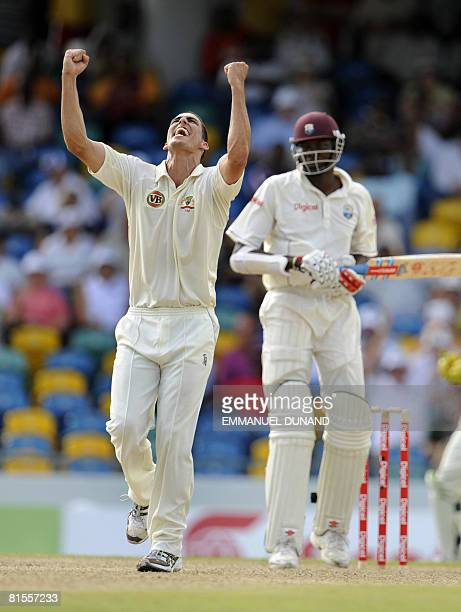 Australian bowler Mitchell Johnson celebrates after taking the wicket of West Indies' batsman Sulieman Benn , during the second day of the third test...