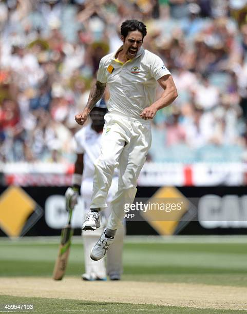 Australian bowler Mitchell Johnson celebrates the wicket of Alastair Cook out LBW on the third day of the fourth Ashes cricket Test match against...