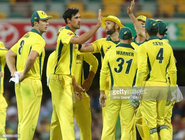 Australian bowler Mitchell Starc celebrates taking a wicket with team mates during game two of the One Day International series between Australia and...