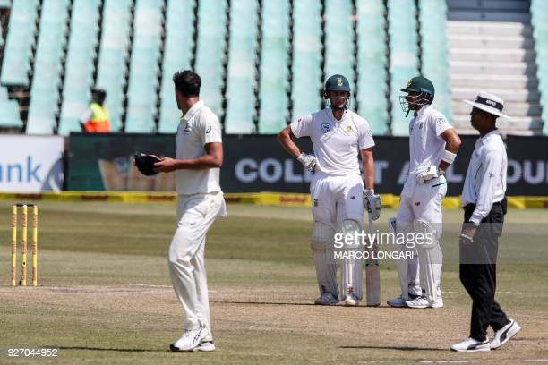 Australian bowler Mitchell Starc sledges South African batsman Theunis de Bruyn during the fourth day of the first Test cricket match between South...