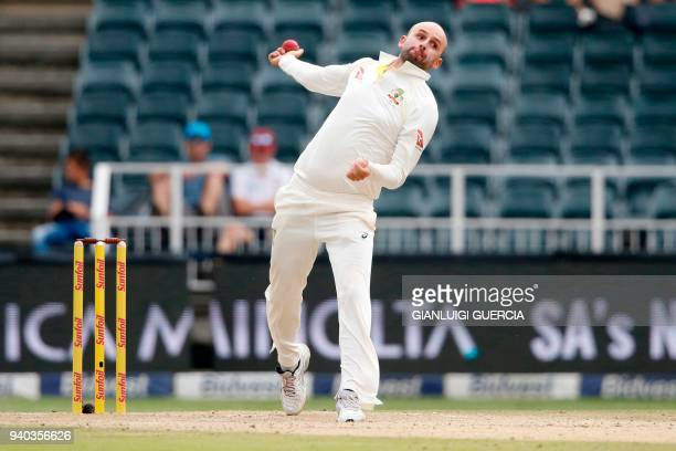 Australian bowler Nathan Lyon bowls on South African batsman Temba Bavuma on the second day of the fourth Test cricket match between South Africa and...