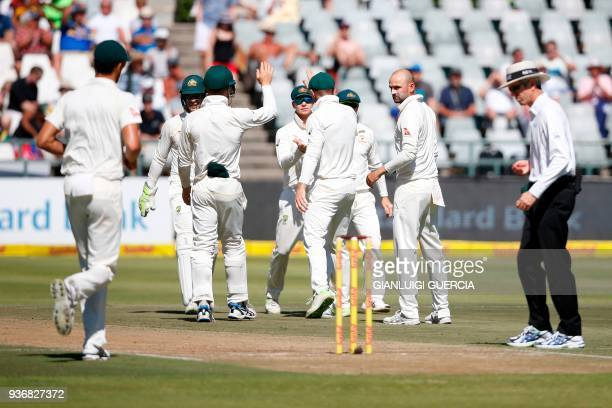 Australian bowler Nathan Lyon celebrates the dismissal of South African batsman Kagiso Rabada during the second day of the third Test cricket match...