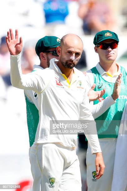 Australian bowler Nathan Lyon celebrates the dismissal of South African batsman Kagiso Rabada and his 300th wicket in test during the fourth day of...