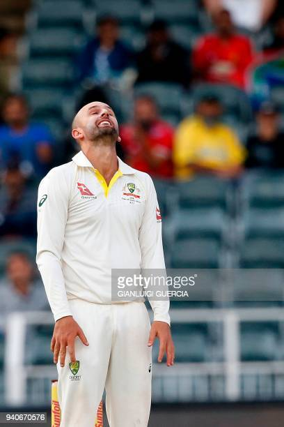 Australian bowler Nathan Lyon reacts after delivering a ball to South African batsman and captain Faf du Plessis on the third day of the fourth Test...