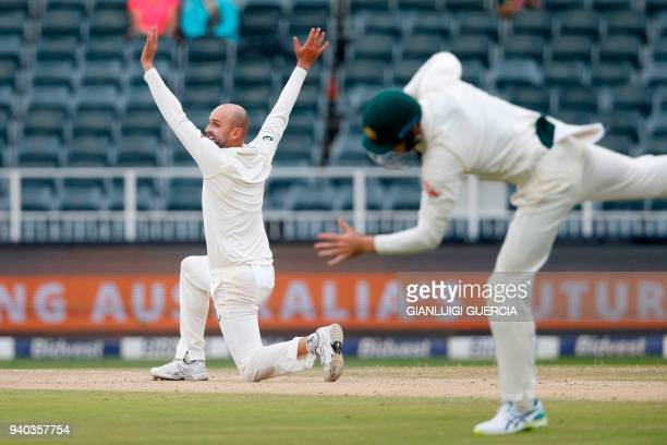 Australian bowler Nathan Lyon reacts on the second day of the fourth Test cricket match between South Africa and Australia won by South Africa at...