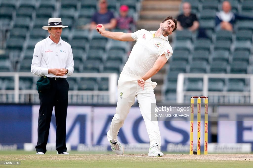 Australian bowler Pat Cummins (R) bowls on South African batsman Dean Elgar (not in picture) on the fourth day of the fourth Test cricket match between South Africa and Australia at Wanderers cricket ground on April 2, 2018 in Johannesburg. /